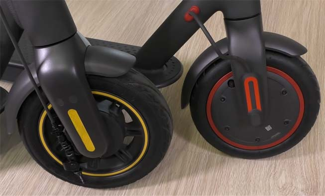 side by side comparing the wheel sizs of xiaomi pro & segway max