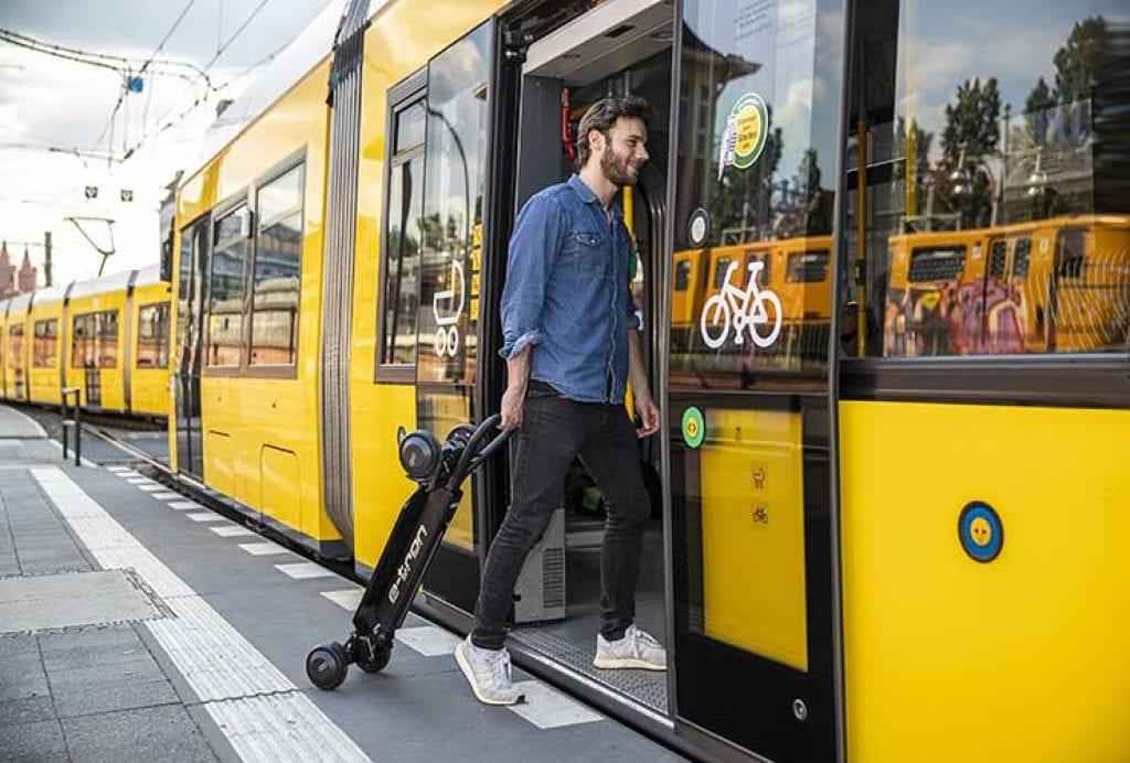 folded scooter taken on a buss or train